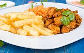 stock photo of fried chicken  - Fried chicken pieces with french fries and sauces - JPG