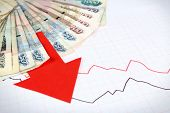 foto of paycheck  - Money and red arrow on graph document close up - JPG