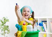 stock photo of cleanse  - Cute kid little girl cleanses a floor in nursery - JPG