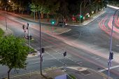 picture of intersection  - Strange and surreal traffic intersection scene with light trails - JPG