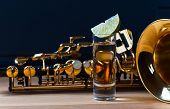 stock photo of saxophones  - saxophone and tequila with lime on wooden table - JPG