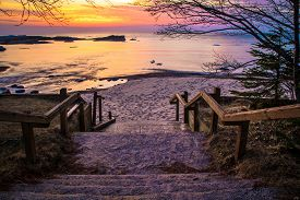 stock photo of nationalism  - Stairs leading to a beautiful Lake Superior sunset beach at the Hurricane River Campground in Pictured Rocks National Lakeshore - JPG