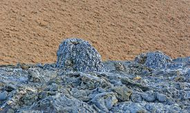 pic of scoria  - Black Spatter Cone against a Red Cinder Cone on Santiago Island in the Galapagos - JPG