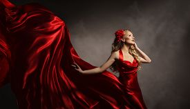 picture of flutter  - Model in Red Dress Glamour Woman Posing in Flying Long Silk Cloth on Wind Beauty Fashion Portrait - JPG