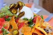 stock photo of nachos  - Serving of Nachos at a Restaurant as an Appetizer - JPG