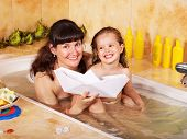 stock photo of mother child  - Mother and child washing in bubble bath  - JPG