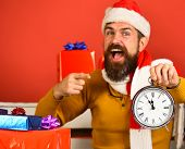 Santa Claus Portrait Pointing At Clock Showing Five To Midnight poster
