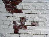 picture of arsenic  - Brick Wall With Some White Paint and Some Red Brick - JPG