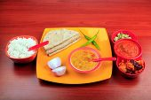 stock photo of tadka  - Simple indian meals with rice chapatti and dal - JPG
