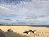 Sandbanks beach Poole, Dorset, United Kingdom in summer with table tennis tables in the foreground a poster