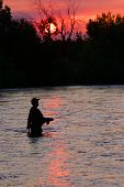 stock photo of boise  - Fly fisherman at sundown on the Boise River - JPG