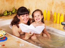 pic of mother child  - Mother and child washing in bubble bath  - JPG