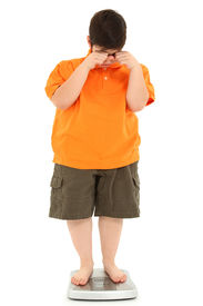 stock photo of morbid  - Morbidly obese fat child on scale crying - JPG