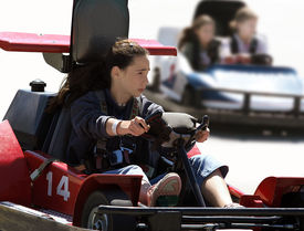 picture of amusement park rides  - girl on go cart - JPG