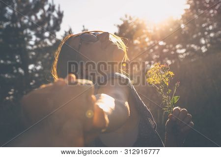 poster of Running In Sunset. Lifestyle Concept. Hipster Woman Running In Sunset In Meadow. Healthy Lifestyle.