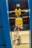 Overhead Traveling Crane With Steel Hooks In Industrial Engeenering Plant Shop. Steel Slings. Bottom poster