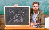 Welcome Back. Teacher Or School Principal Welcomes With Blackboard Inscription Back To School. Teach poster