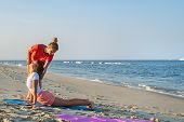 Yoga Trainer. Yoga Class Instructor Helps Beginner To Make Asana Exercises. Woman Doing Yoga With Tr poster