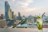 Mojito Cocktail On Table In Rooftop Bar With Bangkok City View Point In Bangkok Thailand. Beautiful  poster