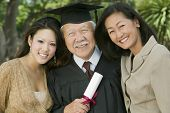 image of early 60s  - Older Graduate with Family - JPG