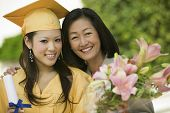 stock photo of graduation  - Mother and Daughter at Graduation - JPG