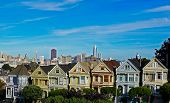 The Painted Ladies Houses Iwith A View Of Downtown San Francisco A Famous Row Of Victorian Houses Th poster