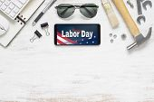 Table Top View Of Labor Day Abstract Background Concept. Flat Lay Mockup Smartphone With Happy Labor poster