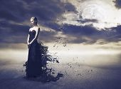 picture of night gown  - Beautiful woman wearing an evening gown melting away - JPG