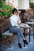 Woman Attractive Elegant Brunette Spend Leisure Cafe Terrace Background. Leisure Concept. Girl Fashi poster