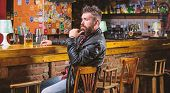 Hipster Relaxing At Bar With Beer. Bar Is Relaxing Place To Have Drink And Relax. Man With Beard Spe poster