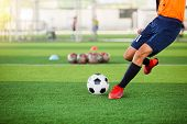 Soccer Player Speed Run To Shoot Ball To Goal On Artificial Turf. Soccer Player Training Or Football poster