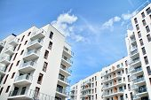 Multistory New Modern Apartment Building. Stylish Living Block Of Flats. poster