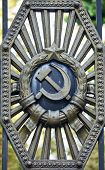 stock photo of armorial-bearings  - Symbols of the Soviet Union in the old gate - JPG