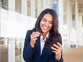 Happy Joyful Businesswoman Getting Funny Message On Phone Outside. Beautiful Young Woman In Office S poster