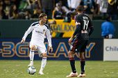 CARSON, CA. - MAY 7: Los Angeles Galaxy M David Beckham #23 keeps the ball away from New York Red Bu