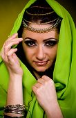 picture of yashmak  - Beautiful young woman in color Arabian clothes - JPG