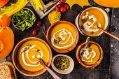 Autumn Pumpkin Soup Puree With Cream In Cups, The Autumn Scenery. Healthy Vegan Food Concept. Autumn poster