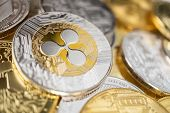 Ripple Physical Coin On The Stack Of Other Different Cryptocurrencies. Close-up Photo Of Ripple With poster