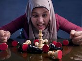 Close Up Portrait Of Beautiful Asian Muslim Woman Gets Angry When Palying Chess, Business Strategy C poster