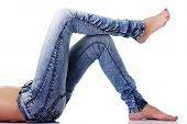 stock photo of bare-assed  - Fit female body in blue jeans - JPG