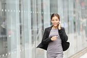stock photo of running-late  - Business woman in motion - JPG