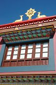 Beautiful Window And Roof Decoration Of Buddhist Monastery- Sculpture Of The Wheel Of Dharma