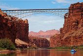 picture of raft  - Rafting under the Navajo Bridges on the Colorado River - JPG
