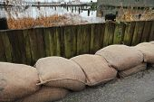 image of sandbag  - A row of sandbags in place for flood protection - JPG