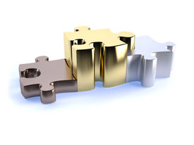 picture of bronze silver gold platinum  - Thre jigsaw peices bronze silver and gold as a poduim concept of winning - JPG