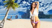 foto of koh phi-phi  - Young woman relaxing on the beach at exotic resort on Phi Phi island - JPG