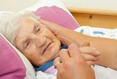 picture of grandma  - Daughter caress on the cheek her elderly mother - JPG