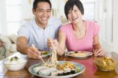stock photo of sm  - Eating Healthy Eating Home Cooking mealmealtime Couple Food 30s Asian Casual Clothing Chinese Chopsticks Color Colour Dining Room Domestic Life Enjoying Happy Holding Home Horizontal Image Indoors Inside Laughing Man mealmealtimetimes Mid Adult Sitting Sm - JPG