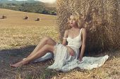 picture of haystacks  - Photo of sexy blonde in a field with haystacks - JPG