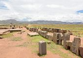 foto of pumapunku  - Panorama of the megalithic stones with intricate carving in the complex Puma Punku - JPG